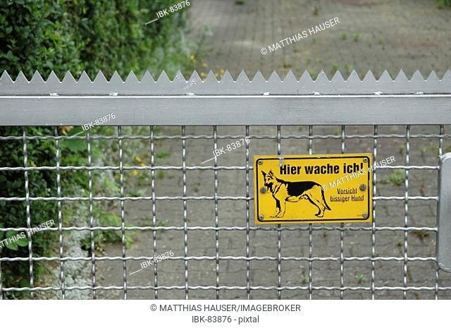 Metall fence with sign - Beware of the dog