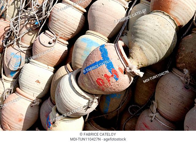 Tunisia - Jerba - Hount-Souk - Amphorae - used to fish octopus - on the quays of the marina