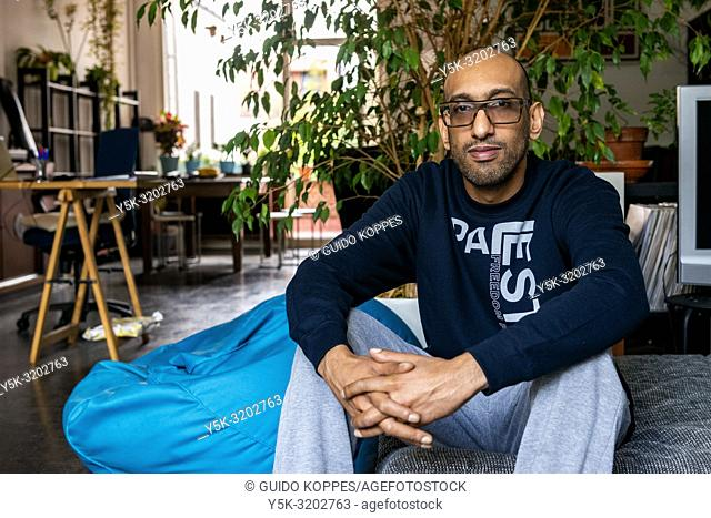 Antwerp, Belgium. Sonny, a Super-host working with the Airbnb hospitality platform works from home as a music producer. He also earns part of his income thanks...