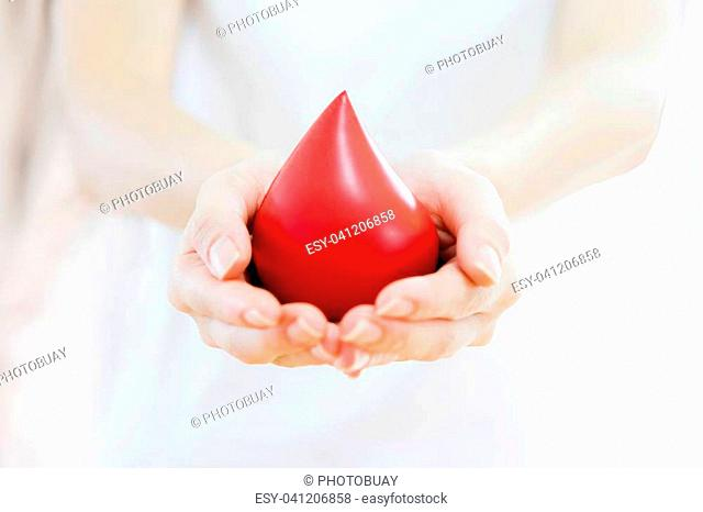 Hands holding a red blood