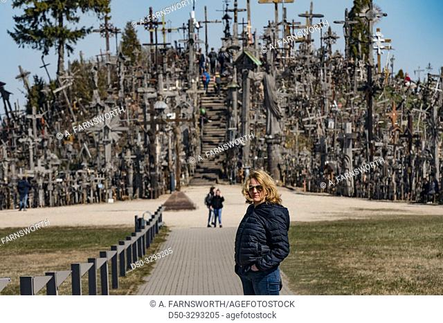 Siauliai, Lithuania A tourist visiting the Hill of Crosses, or, KryžiŠ³ kalnas, a pilgrimage site for Catholics and is a collection of 100,000 crosses