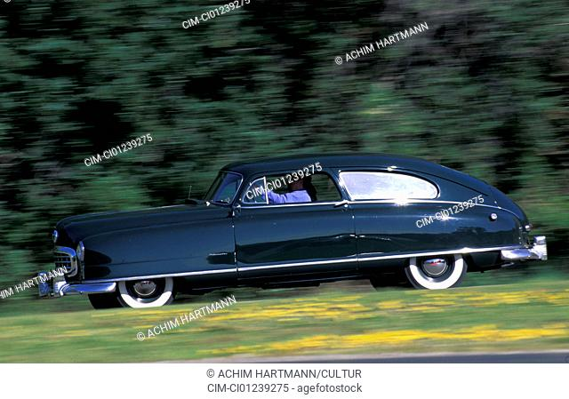 Car, Nash Ambassador, model year 1949, sedan, dark-green, vintage car, 1940s, fourties, streamlined, car body, body shop, carriage, bodywork, driving, road