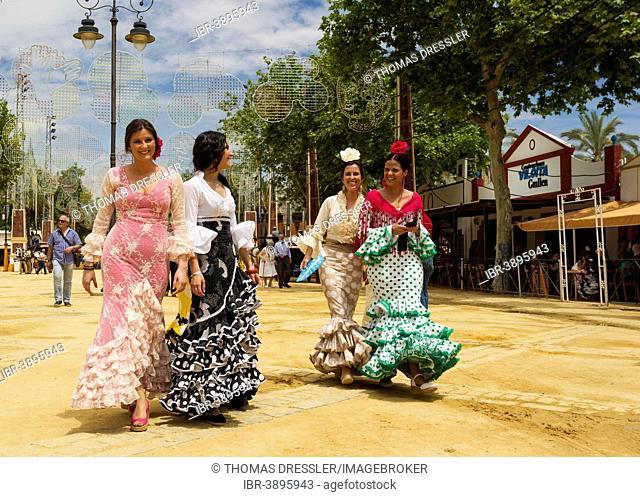 Women wearing gypsy dresses at the Feria del Caballo, Jerez de la Frontera, Cádiz province, Andalusia, Spain