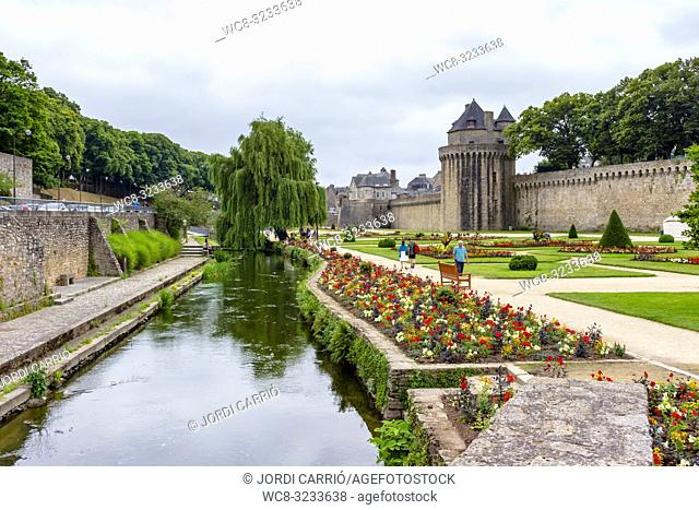 VANNES, BRITTANY, FRANCE - JULY 2015:, BRITTANY, FRANCE: View of the canal and the Gardens of Ramparts, where unknown tourists walk
