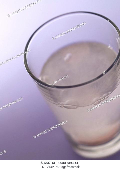 High angle view of pill dissolved in glass of water