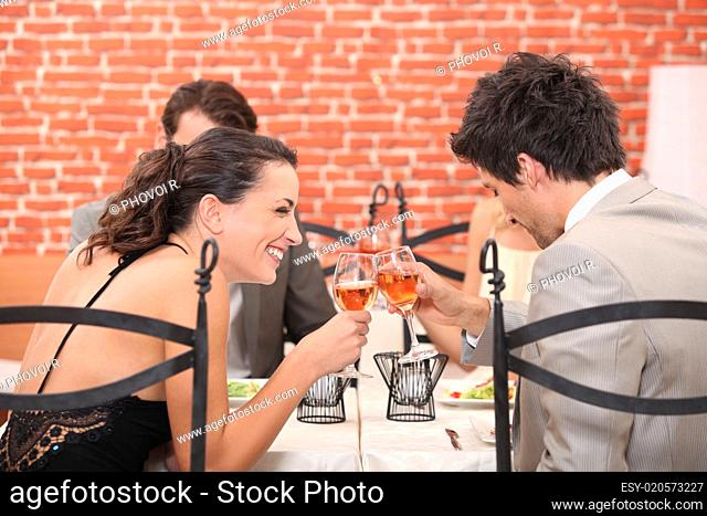 happy couple drinking wine in a restaurant