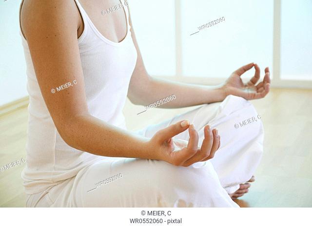 Hands of a meditating woman