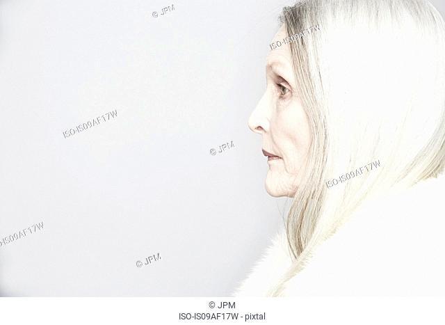 Cropped studio portrait of senior woman in profile