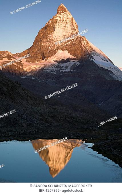 Reflection of Mt. Matterhorn in the Riffelsee lake, Valais, Switzerland, Europe