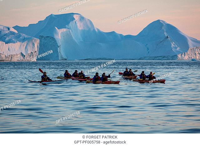KAYAKING AT NIGHTFALL IN FRONT OF THE ICEBERGS IN THE ICE FJORD, JAKOBSHAVN GLACIER, 65 KILOMETRES LONG, COMING FROM THE INLANDSIS, SERMEQ KUJALLEQ, ILULISSAT