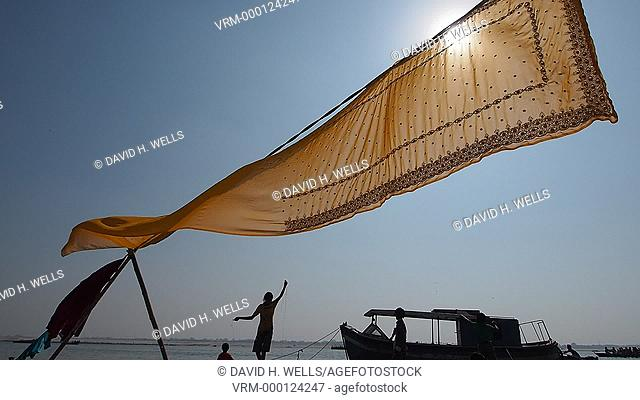Sari being dried in front of a river in Varanasi, Uttar Pradesh, India