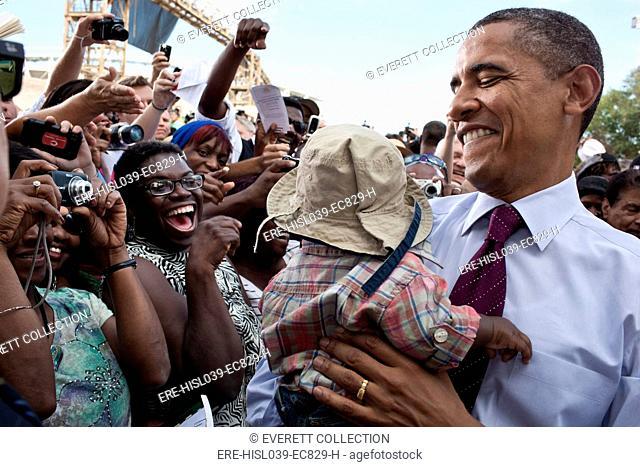 President Barack Obama holds a baby after delivering speaking in Cincinnati, Ohio. Sept. 22, 2011. (BSLOC-2015-3-88)