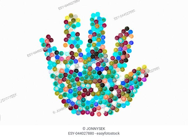 color plastic caps as hand isolated on the white background