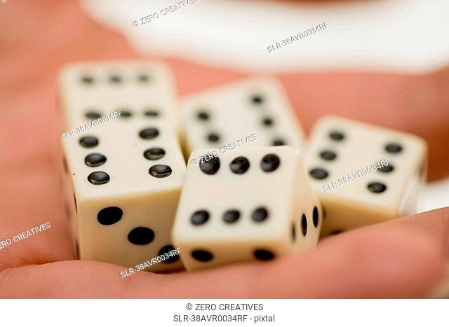 Close up of woman holding dice