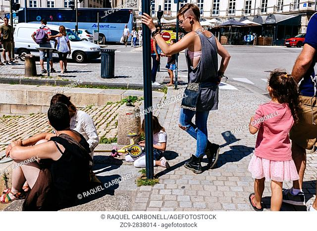 Grunge looking young people at Place Gambetta square, Vannes, Morbihan, Brittany, France