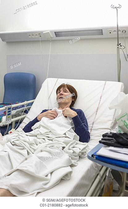 Mature woman in hospital bed
