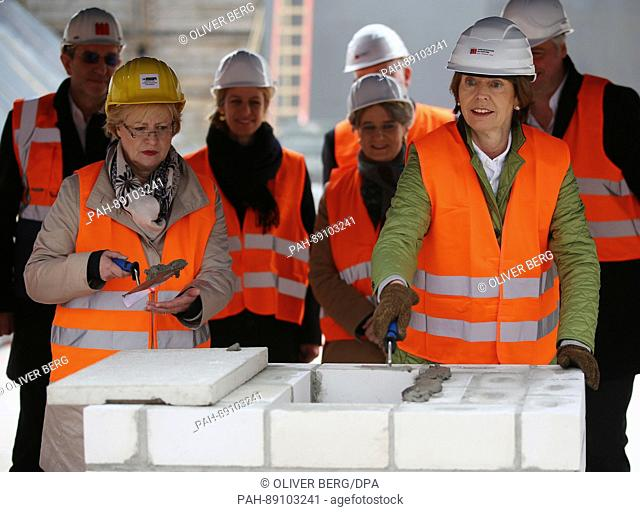 Henriette Reker, the mayor of Cologne, with Bettina Schmidt-Czaia, the head of the city archives, at the site where the new Historical Archive is to be...