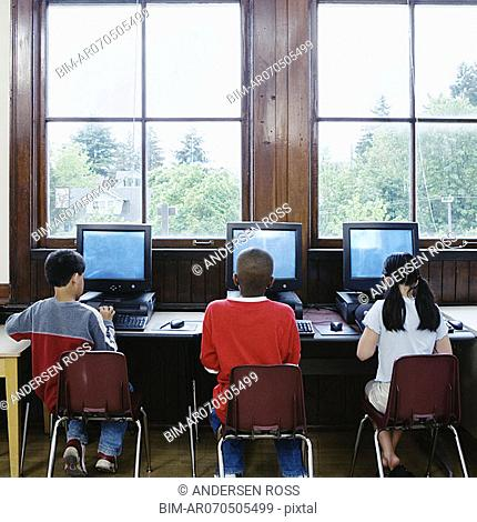 Rear view of students at computers