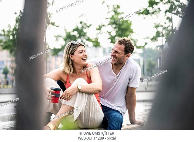 Happy couple sitting on a bench