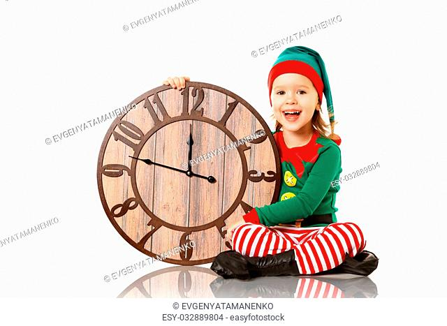 Christmas concept. Little Elf child with clock isolated on white