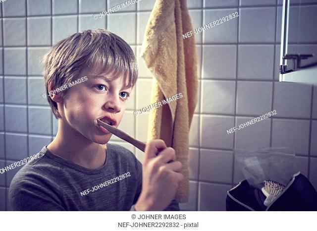 Boy washing teeth