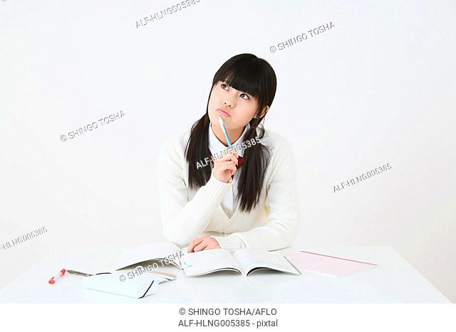 Japanese High-school student in uniform against white background