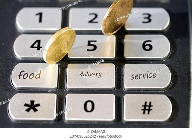 concept of fast and online delivery food with a keyboard and some money