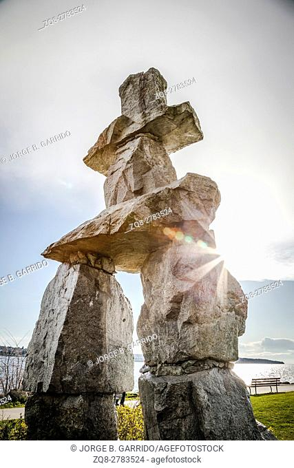 Inukshuk landmark, Canada. Inukshuk is a symbolic structure built by the Inuit man