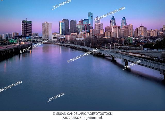 Philadelphia Skyline Pastels - A view to the Philadelphia Skyline during the blue hour at twilight. The urban skyline shows the Comcast Building