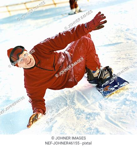 A middle aged man snowboarding, Sweden