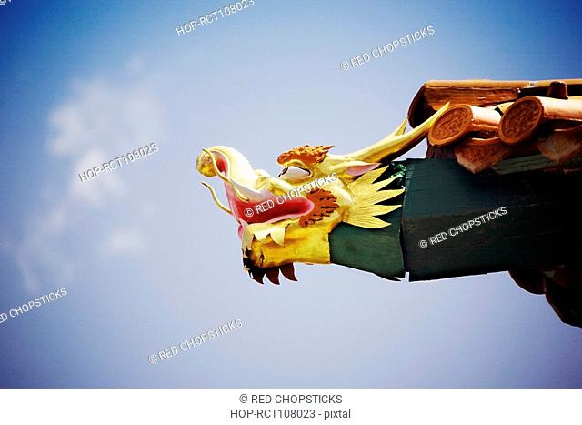Low angle view of a sculpture on roof of a temple, Da Zhao Temple, Hohhot, Inner Mongolia, China