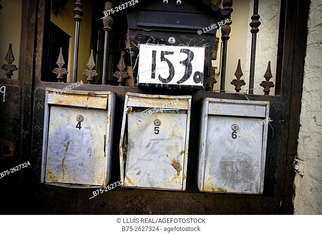 Close up of three mailboxes with numbers 4, 5 and 6 at the gate of a house number 153. East London, England, UK, Europe