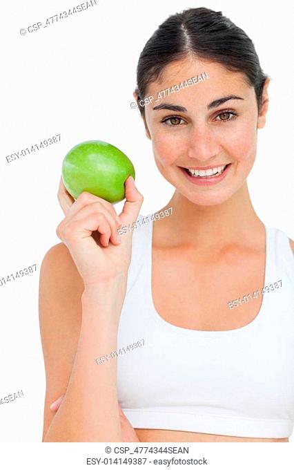 Close-up a brunette holding an green apple