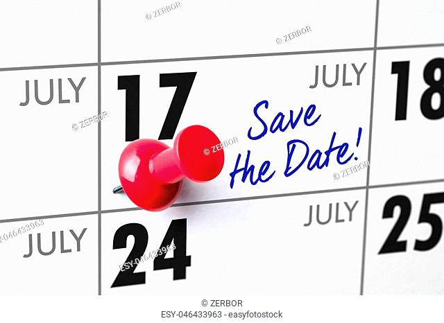 Wall calendar with a red pin - July 17