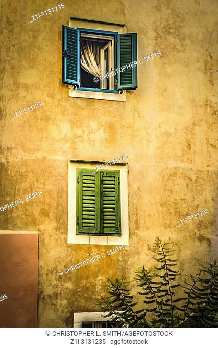 Window shutters on a Croatian home along narrow streets in the small fishing village of Baska on the island of Krk in the Adriatic