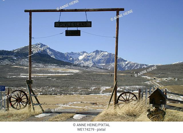 Entrance of farm in foothills of Canadian Rocky Mountains, Alberta, Canada