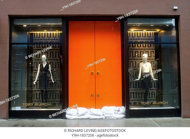 Sandbags are used to protect the entrance to the designer Tory Burch store in the Meatpacking District in New York Hurricane Sandy continues its steady advance...