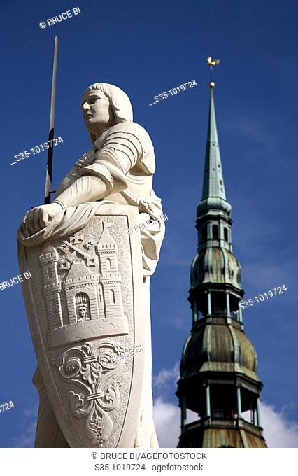 Statue of Roland in Town Hall Square with the tower of St Peter's Church in the background, Riga, Latvia