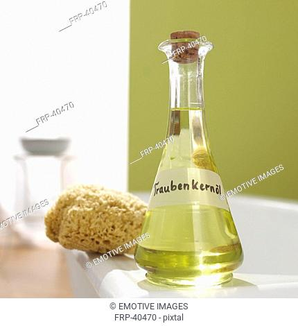 Grapeseed oil and natural sponge at the margin of bath
