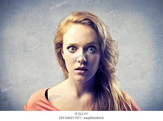 Portrait of woman being suprised