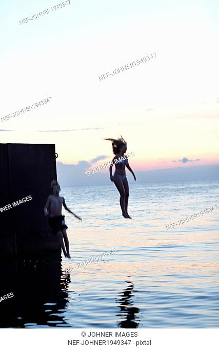 Youth jumping into sea, Oland, Sweden