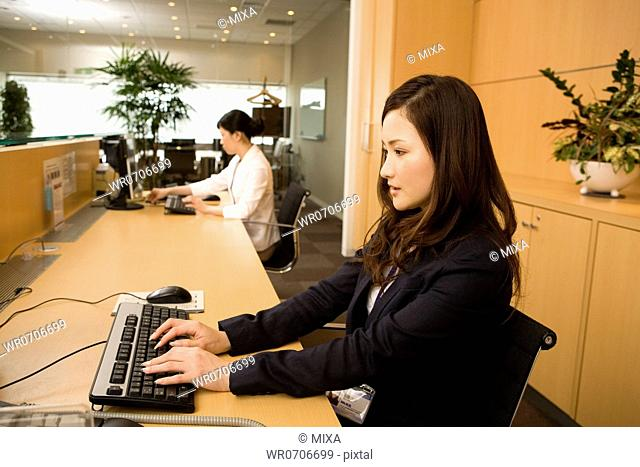 Two businesswomen working at office