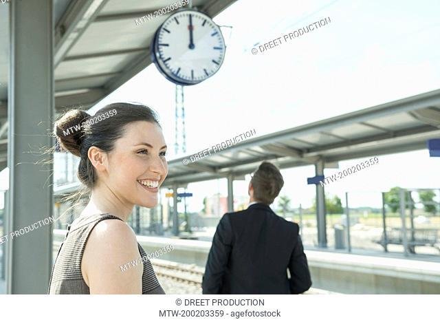 Business partners waiting on platform