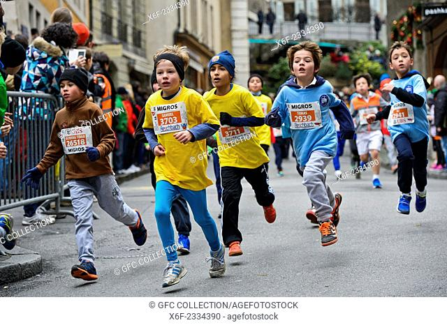8 to 10 years old boys participating in the City run Course de l'Escalade, Geneva, Switzerland