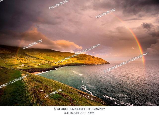 Scenic view of Coumeenole Beach with rainbow, Slea Head Drive, Dingle, Kerry, Ireland