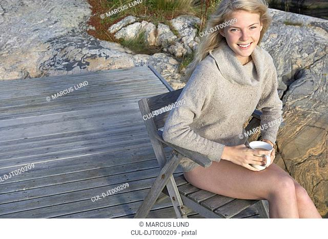 Young Woman relaxing on jetty