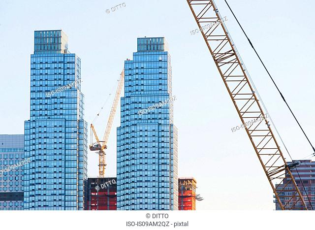 Cranes and buildings, New York, USA