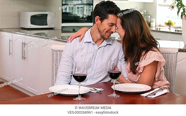 Happy couple drinking red wine together