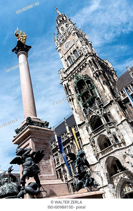 New Town Hall and Mariensaule column, low angle view, Marienplatz, Munich, Germany
