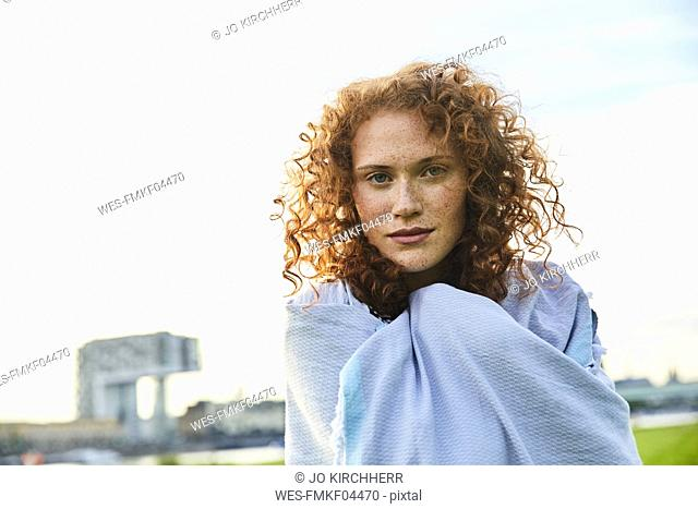 Germany, Cologne, portrait of freckled young woman